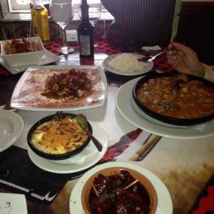 Tapas: pulpo a la gallega, patatas bravas con chorizo, pimientos